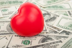 How to Get the Money for Philanthropic Initiatives-red heart and dollar bills